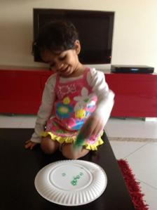 Ask your toddler/preschooler to paint the paper plate green. I used the squeeze bottle to give an effect of dots all around.